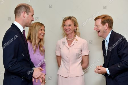 Prince William and Clare Mountbatten (L) speak with Lord and Lady Derby during a visit to James' Place in Liverpool