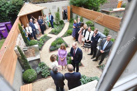 Clare Mountbatten introduces the Prince William to guests in the garden during a visit to James' Place in Liverpool