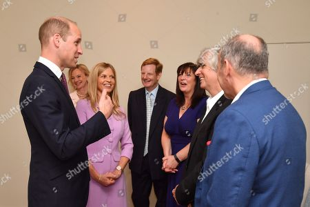 Prince William speaks to Phil Redmond during a visit to James' Place in Liverpool