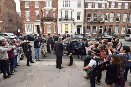 Stock Photo of Nick Wentworth-Stanley and Clare Mountbatten shake hands with Prince William as he leaves James' Place in Liverpool