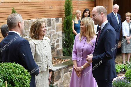 Stock Image of Prince William and Clare Mountbatten speak with garden designer Louise del Balzo during a visit to James' Place in Liverpool