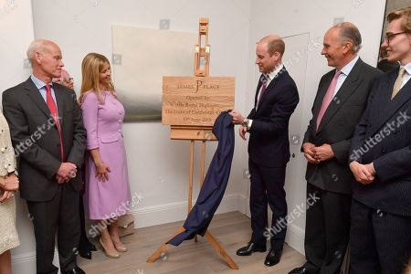 Clare Mountbatten (L) looks-on as Prince William unveils a plaque during a visit to James' Place in Liverpool