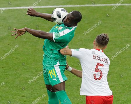 Senegal's Moussa Konate, left, and Poland's Jan Bednarek challenge for the ball during the group H match between Poland and Senegal at the 2018 soccer World Cup in the Spartak Stadium in Moscow, Russia