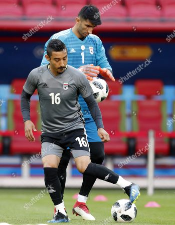 Iran national soccer team goalkeeper Ali Beiranvand (R) and player Reza Ghoochannejhad (L) in action during a training session at the Kazan Arena stadium in Kazan, Russia, 19 June 2018. Iran will face Spain in the FIFA World Cup 2018 Group B preliminary round soccer match on 20 June 2018.