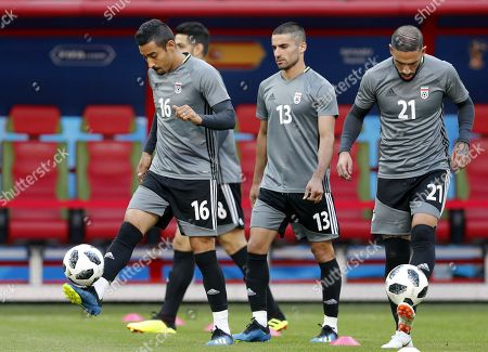 Iran national soccer team players Reza Ghoochannejhad (L), Ashkan Dejagah (C) and Ashkan Dejagah (R) in action during a training session at the Kazan Arena stadium in Kazan, Russia, 19 June 2018. Iran will face Spain in the FIFA World Cup 2018 Group B preliminary round soccer match on 20 June 2018.