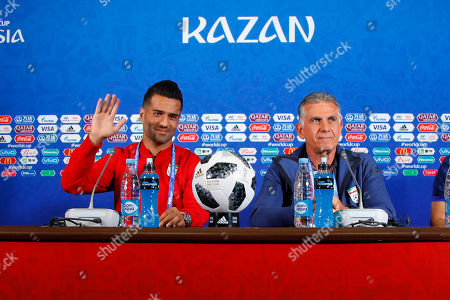 Iran's Masoud Shojaei (L) and head coach Carlos Queiroz during a press conference at the Kazan Arena stadium in Kazan, Russia, 19 June 2018. Iran will face Spain in the FIFA World Cup 2018 Group B preliminary round soccer match  on 20 June 2018.