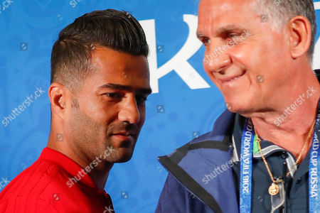 Iran's midfielder Masoud Shojaei (L) arrives for a press conference with head coach Carlos Queiroz at the Kazan Arena stadium in Kazan, Russia, 19 June 2018. Iran will face Spain in the FIFA World Cup 2018 Group B preliminary round soccer match  on 20 June 2018.