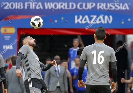 Iran national soccer team players  Ashkan Dejagah (L) and Reza Ghoochannejhad (R) in action during a training session at the Kazan Arena stadium in Kazan, Russia, 19 June 2018. Iran will face Spain in the FIFA World Cup 2018 Group B preliminary round soccer match on 20 June 2018.
