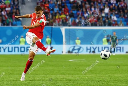 Roman Zobnin of Russia has a shot the deflects off Ahmed Fathy of Egypt for an own goal.