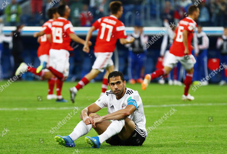 Ahmed Fathy of Egypt looks dejected after scoring an own goal.