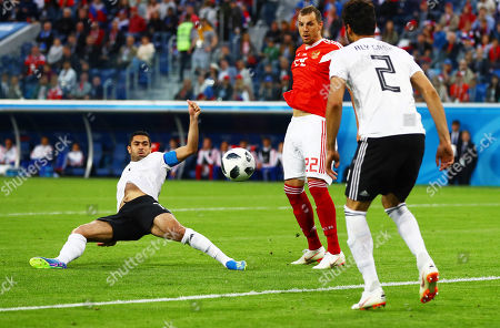 Ahmed Fathy of Egypt deflects the ball in for an own goal.