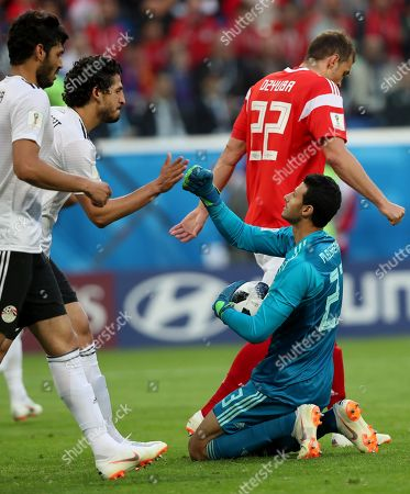 Goalkeeper Mohamed El Shenawy of Egypt in action during the FIFA World Cup 2018 group A preliminary round soccer match between Russia and Egypt in St.Petersburg, Russia, 19 June 2018. (RESTRICTIONS APPLY: Editorial Use Only, not used in association with any commercial entity - Images must not be used in any form of alert service or push service of any kind including via mobile alert services, downloads to mobile devices or MMS messaging - Images must appear as still images and must not emulate match action video footage - No alteration is made to, and no text or image is superimposed over, any published image which: (a) intentionally obscures or removes a sponsor identification image; or (b) adds or overlays the commercial identification of any third party which is not officially associated with the FIFA World Cup)