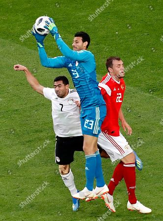Artem Dzyuba of Russia, Ahmed Fathi of Egypt and Goalkeeper Mohamed El Shenawy of Egypt