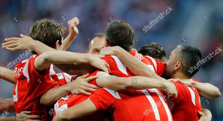 Russia's team players celebrate after Egypt's Ahmed Fathy scoring the own goal, the opening goal of the group A match between Russia and Egypt at the 2018 soccer World Cup in the St. Petersburg stadium in St. Petersburg, Russia