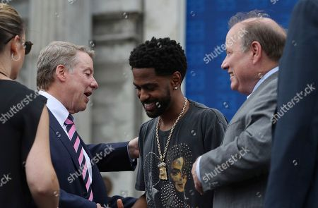 Bill Ford, Big Sean. Ford Motor Co., Executive Chairman Bill Ford, left, meets with rapper Big Sean outside the Michigan Central train depot, in Detroit. Ford Motor Co. is embarking on a 4-year renovation of the 105-year-old depot and 17-story office tower just west of downtown. The massive project is expected to increase the automaker's footprint in the city where the company was founded, provide space for electric and autonomous vehicle testing and research, and spur investment in the surrounding neighborhood