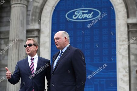 Bill Ford, James Hackett. Ford Motor Co., Executive Chairman Bill Ford, left, and CEO James Hackett pose outside the Michigan Central train depot, in Detroit. Ford Motor Co. is embarking on a 4-year renovation of the 105-year-old depot and 17-story office tower just west of downtown. The massive project is expected to increase the automaker's footprint in the city where the company was founded, provide space for electric and autonomous vehicle testing and research, and spur investment in the surrounding neighborhood