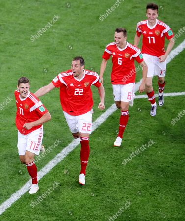Roman Zobnin of Russia celebrates after his shot deflects off Ahmed Fathy of Egypt for an own goal.