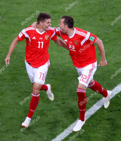Stock Photo of Roman Zobnin of Russia celebrates after his shot deflects off Ahmed Fathy of Egypt for an own goal.