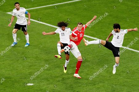 Stock Picture of Artem Dzyuba of Russia and Ali Gabr of Egypt.