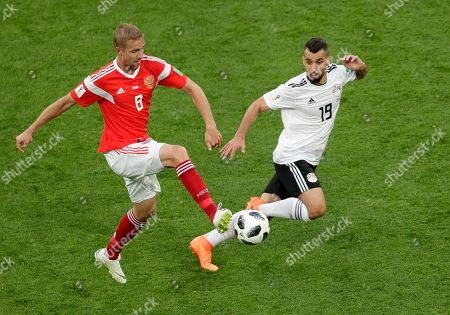 Russia's Yuri Gazinsky, left, and Egypt's Abdalla Said challenge for the ball during the group A match between Russia and Egypt at the 2018 soccer World Cup in the St. Petersburg stadium in St. Petersburg, Russia
