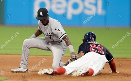 Tim Anderson, Rajai Davis. Cleveland Indians' Rajai Davis steals to second base as Chicago White Sox's Tim Anderson is late on the tag in the seventh inning of a baseball game, in Cleveland