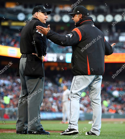 Andy Fletcher, Don Mattingly. Miami Marlins manager Don Mattingly, right, argues with home plate umpire Andy Fletcher during the second inning of the team's baseball game against the San Francisco Giants, in San Francisco