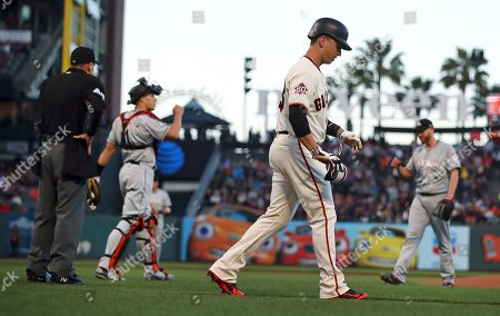 Buster Posey, Andy Fletcher, Dan Straily. Hume plate umpire Andy Fletcher, left, ejects Miami Marlins pitcher Dan Straily, right, after Straily hit San Francisco Giants' Buster Posey, foreground, with a pitch during the second inning of a baseball game, in San Francisco