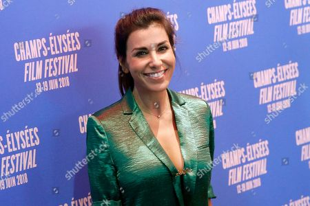 Actress Reem Kherici poses during a photocall as part of the Champs Elysees Film Festival, in Paris