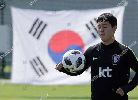 South Korea's Ju Se-jong controls the ball during a training session of South Korea at the 2018 soccer World Cup at the Spartak Stadium in Lomonosov near St. Petersburg, Russia
