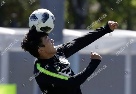 South Korea's Go Yo-han heads the ball during a training session of South Korea at the 2018 soccer World Cup at the Spartak Stadium in Lomonosov near St. Petersburg, Russia