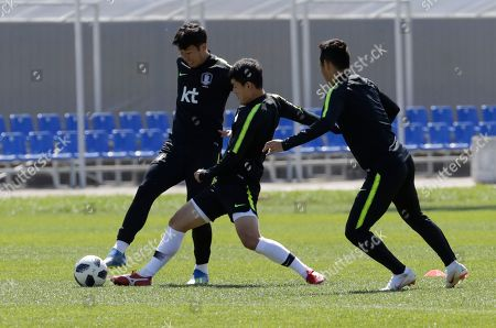 Son Heung-min, Ju Se-jong, Moon Seon-min. South Korea's Son Heung-min, left, goes for the ball with Ju Se-jong, center, and Moon Seon-min, right, during a training session of South Korea at the 2018 soccer World Cup at the Spartak Stadium in Lomonosov near St. Petersburg, Russia