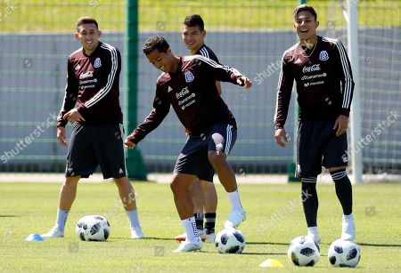 Mexican players Hector Herrera (L), Giovani dos Santos (2-L), Hirving Lozano and Carlos Salcedo (R) during a training in Moscow 20 June 2018. Mexico will face South Korea in the FIFA World Cup 2018 Group F preliminary round soccer match on 23 June 2018. The FIFA World Cup 2018 takes place in Russia from 14 June until 15 July 2018.
