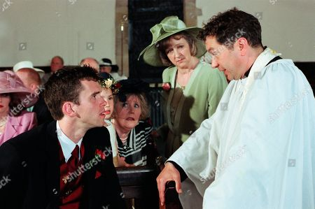 Stock Photo of Ep 2559  Thursday 5th August 1999 Graham is determined to break up Kathy and Biff's wedding day, confronting Biff and telling him that Kathy has feelings for him. Kathy though is convinced from that incident that she should marry Biff. As Graham shows up during the vows, Biff begins to have doubts and decides Kathy isn't committed to him. He jilts her at the altar, leaving Kathy traumatised. With Marlon Dingle, as played by Mark Charnock ; Betty Eagleton, as played by Paula Tilbrook ; Caroline Bates, as played by Diana Davies ; Rev Ashley Thomas, as played by John Middleton.