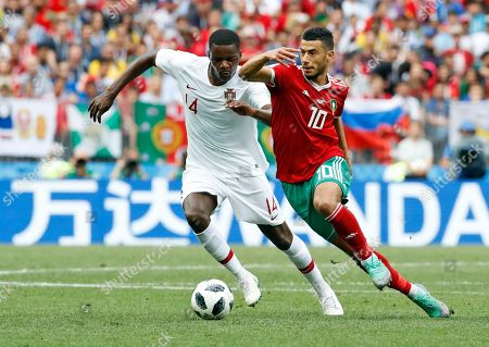 Morocco's Mbark Boussoufa, left, is challenged by Portugal's Joao Mario during the group B match between Portugal and Morocco at the 2018 soccer World Cup at the Luzhniki Stadium in Moscow, Russia