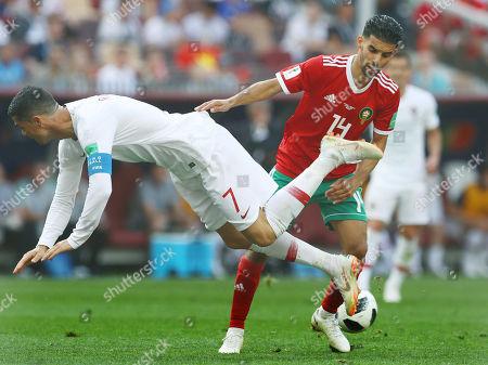 Cristiano Ronaldo of Portugal and Mbark Boussoufa of Morocco