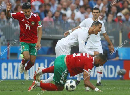 Mehdi Benatia of Morocco slides into Cristiano Ronaldo of Portugal