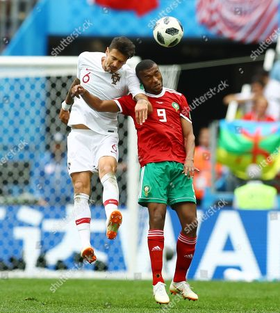 Jose Fonte of Portugal and Ayoub El Kaabi of Morocco