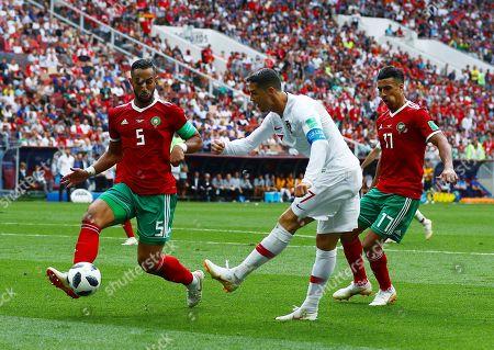 Cristiano Ronaldo of Portugal takes a shot under pressure from Mehdi Benatia of Morocco