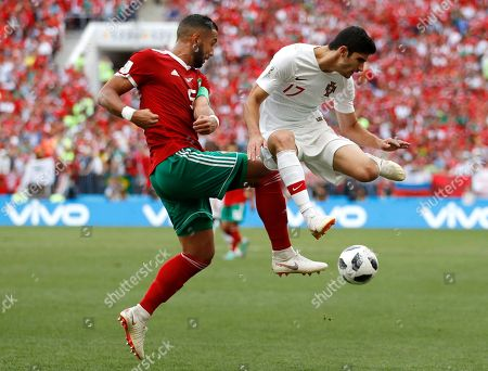 Portugal's Goncalo Guedes, right, challenges for the ball Morocco's Mehdi Benatia, left, during the group B match between Portugal and Morocco at the 2018 soccer World Cup in the Luzhniki Stadium in Moscow, Russia