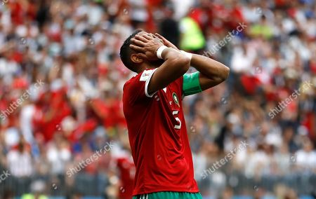 Morocco's Mehdi Benatia covers his faces after missing a chance to score during the group B match between Portugal and Morocco at the 2018 soccer World Cup in the Luzhniki Stadium in Moscow, Russia