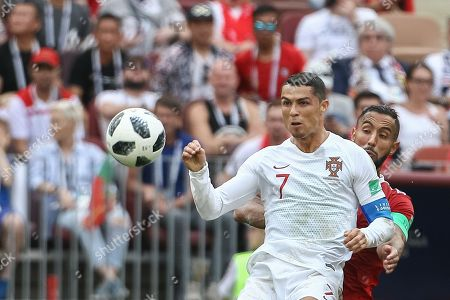 Cristiano Ronaldo (L) of Portugal in action against Mehdi Benatia of Morocco during the FIFA World Cup 2018 group B preliminary round soccer match between Portugal and Morocco at the Luzhniki Stadium, in Moscow, Russia, 20 June 2018. (RESTRICTIONS APPLY: Editorial Use Only, not used in association with any commercial entity - Images must not be used in any form of alert service or push service of any kind including via mobile alert services, downloads to mobile devices or MMS messaging - Images must appear as still images and must not emulate match action video footage - No alteration is made to, and no text or image is superimposed over, any published image which: (a) intentionally obscures or removes a sponsor identification image; or (b) adds or overlays the commercial identification of any third party which is not officially associated with the FIFA World Cup)