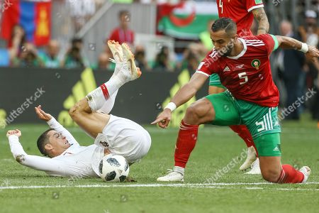 Cristiano Ronaldo (L) of Portugal in action against Mehdi Benatia (R) of Morocco during the FIFA World Cup 2018 group B preliminary round soccer match between Portugal and Morocco at the Luzhniki Stadium, in Moscow, Russia, 20 June 2018. (RESTRICTIONS APPLY: Editorial Use Only, not used in association with any commercial entity - Images must not be used in any form of alert service or push service of any kind including via mobile alert services, downloads to mobile devices or MMS messaging - Images must appear as still images and must not emulate match action video footage - No alteration is made to, and no text or image is superimposed over, any published image which: (a) intentionally obscures or removes a sponsor identification image; or (b) adds or overlays the commercial identification of any third party which is not officially associated with the FIFA World Cup)