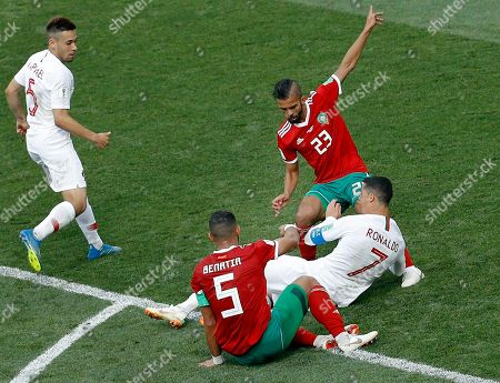 Portugal's Cristiano Ronaldo, bottom right, is fouled by Morocco's Mehdi Benatia, front, during the group B match between Portugal and Morocco at the 2018 soccer World Cup in the Luzhniki Stadium in Moscow, Russia
