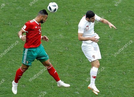 Morocco's Mehdi Benatia, left, and Portugal's Goncalo Guedes, right, go for a header during the group B match between Portugal and Morocco at the 2018 soccer World Cup in the Luzhniki Stadium in Moscow, Russia