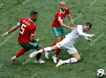Morocco's Mehdi Benatia, left, and Morocco's Karim El Ahmadi, center, challenge for the ball with Portugal's Cristiano Ronaldo, right, during the group B match between Portugal and Morocco at the 2018 soccer World Cup in the Luzhniki Stadium in Moscow, Russia