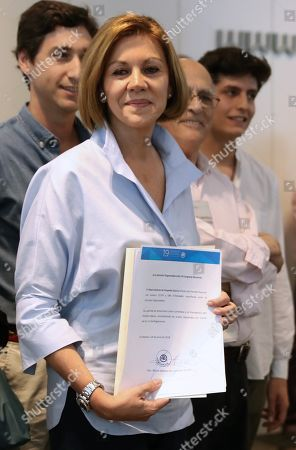 Aspirant to lead the People's Party (PP) former Defense Minister Maria Dolores de Cospedal (L) hands in her support signatures at the party's headquarters in Madrid, Spain, 20 June 2018. Aspirants need a minimum number of signatures of registered voters within the party in order to run for internal elections.