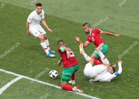 Stock Image of Cristiano Ronaldo of Portugal is awarded a free kick for a challenge from Mehdi Carcela-Gonzalez and Mehdi Benatia of Morocco