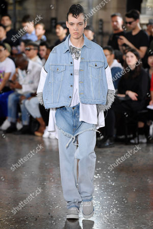 Stock Picture of A model presents a creation from the Spring/Summer 2019 men's Collection by Japanese designer Hiromichi Ochiai for Facetasm during the Paris Fashion Week, in Paris, France, 20 June 2018. The presentation of the Men's collections runs from 19 to 24 June.