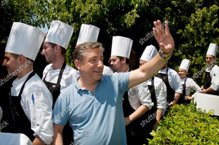 Spanish chef Joan Roca greets his workers as he arrives to his restaurant 'Celler de Can Roca' in Girona, Spain, 20 June 2018, a day after the restaurant was listed second on the 50 Best World Restaurants.