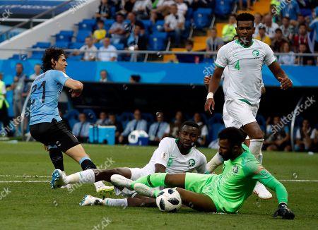 Edinson Cavani of Uruguay and Goalkeeper Mohammed Al-Owais of Saudi Arabia